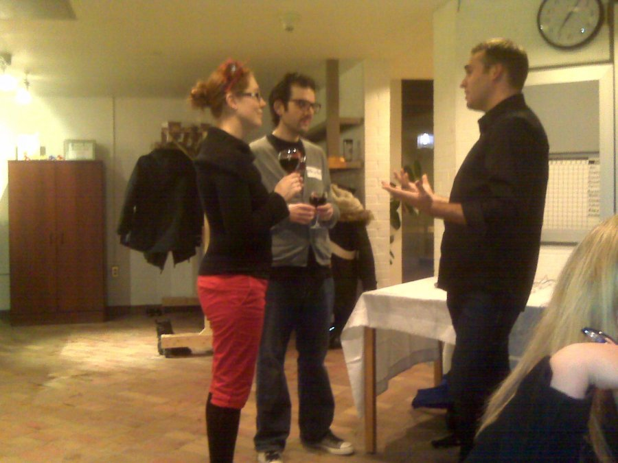Justin from Wonderful Waterloo talks to volunteers Sarah and Benjamin Bach.